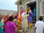 Devotees enter the newly built Lakshmi Mandir for the first time.