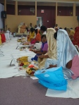 Devotees engrossed in Puja under Shri Sadgurudev Ji Maharaj's guidance