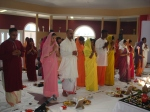 Devotees in prayer - all Yajmaans are dressed in Dhoti for men and Saaree for women
