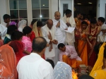 Devotees engaged in the Yagya Purnahuti