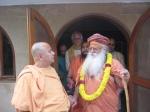 Swami Shri Gurusharananand Ji Maharaj & Shri Sadgurudev Ji Maharaj with Shri Jagadanand Das Ji in the background