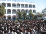 Children in attentive assembly at the school in Mathura