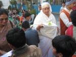 Shri Madhu Mata (in white) of Thakur Dwar in Haryana and Shri Nirmal Mata Marwaha of Glasgow distributing gifts to all the children