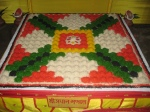 Shri Sarvatobhadra Mandala - the Mandala upon which Shri Thakurji is worshipped along with all His servant deities