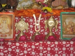 Shri Tilak-Shankha-Chakra being worshipped on the Altar