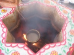 Cooking the offerings of Charu on the fire of the Yagya Kunda