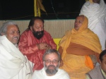Swami Shri Arjun Puriji with Shri Sadgurudev Ji Maharaj, Shri Vishnu Kant Ji Shastri and Shri Medinipati Mishra ji, Priest of Glasgow Hindu Mandir UK who was visiting for darshan