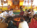 Devotees participating in the Yagya