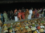 Sants and devotees having darshan of chhappan bhog of Thakurji's prasadam to Shri Ganga Mata